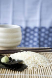 Japanese rice on mat Royalty Free Stock Photography