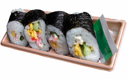Japanese rice rolls. Some rice rolls with vegetables,eggs and shrimp,and covered by sea plants Stock Photo