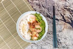 Japanese rice topped boil eggs and fried pork. Stock Images