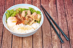 Japanese rice topped boil eggs and fried pork. Stock Photo