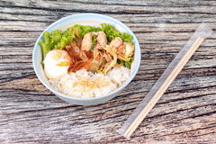 Japanese rice topped boil eggs and fried pork. Japanese cuisine , Rice with soft boil eggs and fried pork topped white sesame and slicrd dried mackarel in royalty free stock image