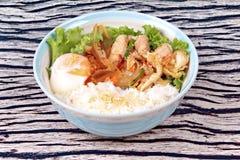Japanese rice topped boil eggs and fried pork. Japanese cuisine , Rice with soft boil eggs and fried pork topped white sesame and slicrd dried mackarel in stock photo