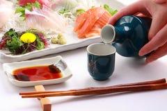 Japanese rice wine Sake and Mixed Sashimi Platter, Japanese food stock photo