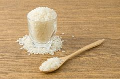 Japanese Rice in Wooden Spoon and Glass Cup Stock Image