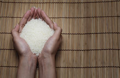 Japanese rice in your hand on Japanese mats Stock Images