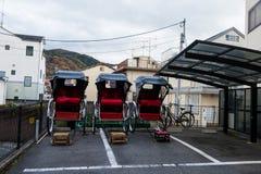 Japanese rickshaw jinrikisha at Arashiyama. Japanese rickshaw or jinrikisha at Arashiyama city with autumn foliage colors at mountain Stock Photo