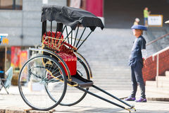 Japanese rickshaw man awaiting for the customers. Two wheel carriage staying aside. Nagasaki, Japan Royalty Free Stock Photography