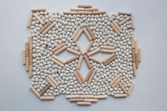 Japanese rock garden concept with white kidney beans and wooden sticks stock photo