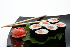 A Japanese roll. A sushi roll with ginger and stick on Japanese plate Stock Photography