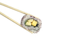 Japanese roll in chopsticks royalty free stock photography