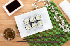 Japanese roll with cucumber and fresh sakura branch Royalty Free Stock Photo