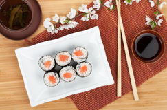 Japanese roll with salmon and fresh sakura branch Royalty Free Stock Images