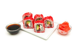 Japanese rolls with avocado and caviar close-up on a white backg Royalty Free Stock Photo
