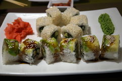 Japanese rolls with avocado, wasabi and ginger Royalty Free Stock Images
