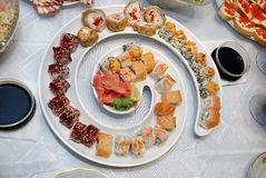 Japanese rolls on a beautiful dish. Food is beautiful tableware Stock Images