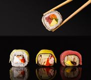 Japanese rolls on black mirroring background