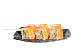 Japanese  rolls on black plate. Royalty Free Stock Photos