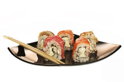 Japanese  rolls on black plate. Royalty Free Stock Photo
