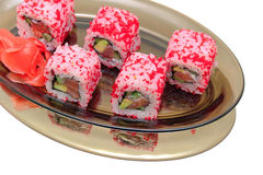 Japanese rolls with caviar, avocado and salmon on a plate Stock Photo