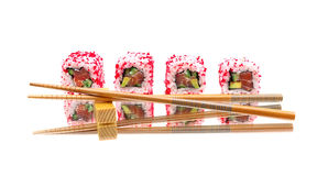 Japanese rolls and chopsticks on mirror surface Royalty Free Stock Photography