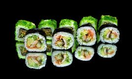 Japanese rolls close-up on black background with reflection Stock Image