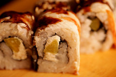 Japanese rolls with eel on a wooden plank royalty free stock photos
