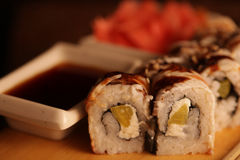 Japanese rolls with eel on a wooden plank royalty free stock image