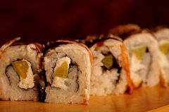 Japanese rolls with eel on a wooden plank stock photography
