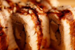 Japanese rolls with eel on a wooden plank royalty free stock images