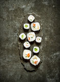 Japanese rolls with fish and vegetables. On the stone table Stock Images