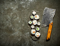 Japanese rolls with a hatchet for cutting. Stock Images