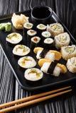 Japanese rolls Hosomaki, Uramaki, Maki, Nigiri, Tamagoyaki with various fillings close-up on a plate. vertical. Japanese rolls Hosomaki, Uramaki, Maki, Nigiri royalty free stock photography