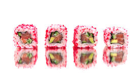 Japanese rolls with a mirror reflection. white background. Royalty Free Stock Images