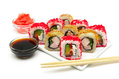 Japanese rolls, pickled ginger and soy sauce on a white backgrou Royalty Free Stock Image