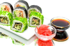 Japanese rolls, pickled ginger and soy sauce on a white backgrou Stock Image