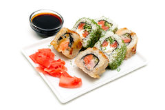 Japanese rolls on a plate with ginger and soy sauce. Stock Photography