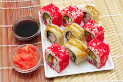 Japanese rolls on a plate with soy sauce and pickled ginger Royalty Free Stock Images