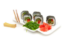 Japanese rolls on a plate on a white background Royalty Free Stock Photo