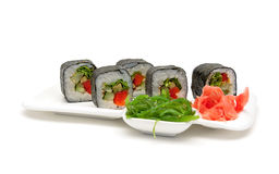 Japanese rolls on a plate on a white background Stock Photo