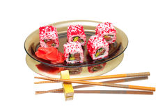 Japanese rolls on a plate on a white background with mirror refl Stock Photos