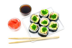 Japanese rolls on a plate on white background Stock Photo