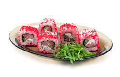 Japanese rolls with red caviar and chuka salad on a plate on a w Royalty Free Stock Photo