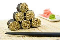 Japanese rolls with sesame and spice. Japanese rolls with sesame, wasabi, ginger and sticks Stock Photos