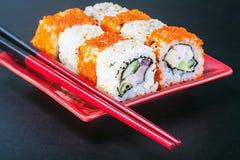 Japanese rolls on sticks Stock Photos