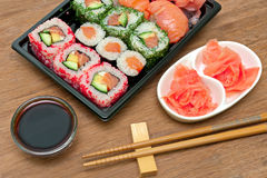 Japanese rolls and sushi, soy sauce and pickled ginger Royalty Free Stock Photography