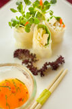 Japanese Rolls With Sweet Sauce. Appetizer of Japanese rolls with sweet sauce and chopsticks Royalty Free Stock Image
