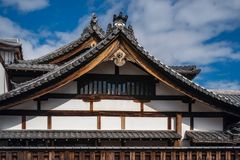 Japanese Roof Detail at a shrine in Kyoto. Roof detail with the specific roof tiles of a traditional Japanese Shrine complex in Gion, Kyoto, Japan royalty free stock images