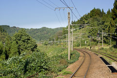 Japanese rural railline. A rural Japanese rail line in the mountains royalty free stock photos