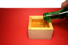 Japanese sacred sake and wooden cup in the new year mood #2 Royalty Free Stock Photography