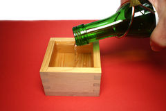 Japanese sacred sake and wooden cup in the new year mood Stock Photo